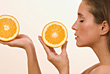 Woman Holding Sliced Orange stock photography