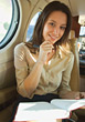 Woman In Business Aircraft Cabin stock photo