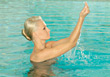 Woman In Swimming Pool stock photo