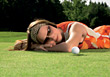 Golfer Woman Laying In Golf Course Grass stock image