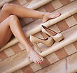 Woman's Legs With High Hill Shoes stock photo