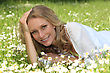 Woman Lying In A Grassy Field stock photo