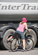 Biking Woman on Bike Colliding with Truck stock photo