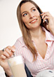 Woman on Cell Stirring Ice Coffee stock photo