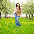 Woman On The Meadow In The Blooming Garden stock photo