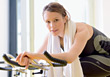 Woman On Stationary Bike stock photo