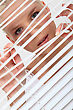 Overlap Woman Peering Through Some Blinds stock photo