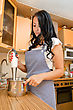 Woman Preparing Food With A Handblender In Her Kitchen stock photography