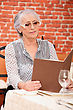 Woman Reading Menu In Restaurant stock image