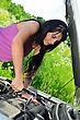 Car Mechanics Woman Repairing Broken Car With A Socket Spanner Wrench. stock photo