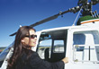 Woman Stepping Into Helicopter stock photo