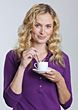 Woman Stirring Coffee Cup stock photo