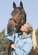 Woman Stroking Thoroughbred Horse stock image