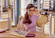 Woman Trying On Eyeglass Frames stock photo