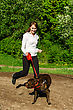Dogs Woman Walking With An American Stafford In The Park stock photo