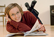 Smiling Woman Wearing Glasses Reading On Floor stock photo