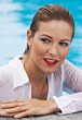 Vacation Woman with Wet Blouse at Swimming Pool stock image