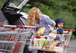 Woman with Baby Grocery Shopping stock image