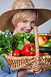Regional Woman With Basket Of Vegetables stock photography