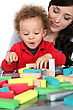 Woman With Child And Blocks stock image