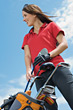 Woman with Golf Clubs stock photo