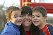 Woman with two boys stock photo