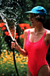 Laughing Woman with Waterhose stock photo