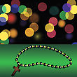 Wood Cross On Green Table. Blurred Colorful Lights Background. Wooden Religious Cross And Rosary
