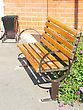 Wooden Bench In Park In A Garden With Metal Hand-rail stock photo