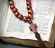 Wooden Rosary And The Bible stock photography