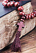 Wooden Rosary Are On An Old Bible stock photo