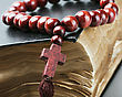 Wooden Rosary Lying On A Closed Bible stock photography