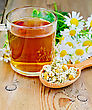 Wooden Spoon With Dried Chamomile Flowers, A Bouquet Of Fresh Flowers Of Chamomile Tea In Glass Mug On The Background Of Wooden Boards stock photography