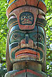 Wooden Totem Pole, Monumental Sculpture Carved From Large Tree stock photo