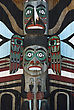 Wooden Totem Pole, Monumental Sculpture Carved From Large Tree stock photography