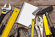 Item Work Tools And Notebook On The Wooden Background stock photo
