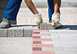 Worker Laying Brick Pavement stock photography