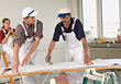 Workers Laying Wallpaper stock photo