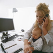 Adult Working Mom with Baby on Lap stock image