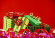 Wrapped Boxes With Presents Against Red Background stock image