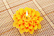 Yellow Flower Candle Isolated On Bamboo Background. stock photography