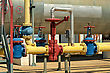 Industry Yellow Gas Pipe And Valve Red, Blue Dotted Gate stock photo