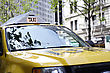 Windscreen Yellow Taxi Cab In The Street With It's Sign Illuminated stock photo