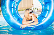 Dot Young Blond Woman Posing In Rubber Ring stock photo