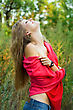 Young Blond Woman In Red Scarf Getting Pleasure Outdoor stock image