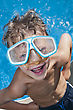 Young Boy With Attitude Showing His Muscles And Wearig Swiming Googles stock image
