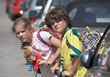 Young Boy & Girl Crossing The Street stock image