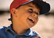 Young Boy Wearing Baseball Cap Smiling stock photography