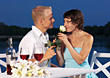 Young Couple at Romantic Dinner By The Water stock photo
