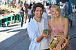 Young Couple With A Basket Of Fruit In A Busy Marketplace